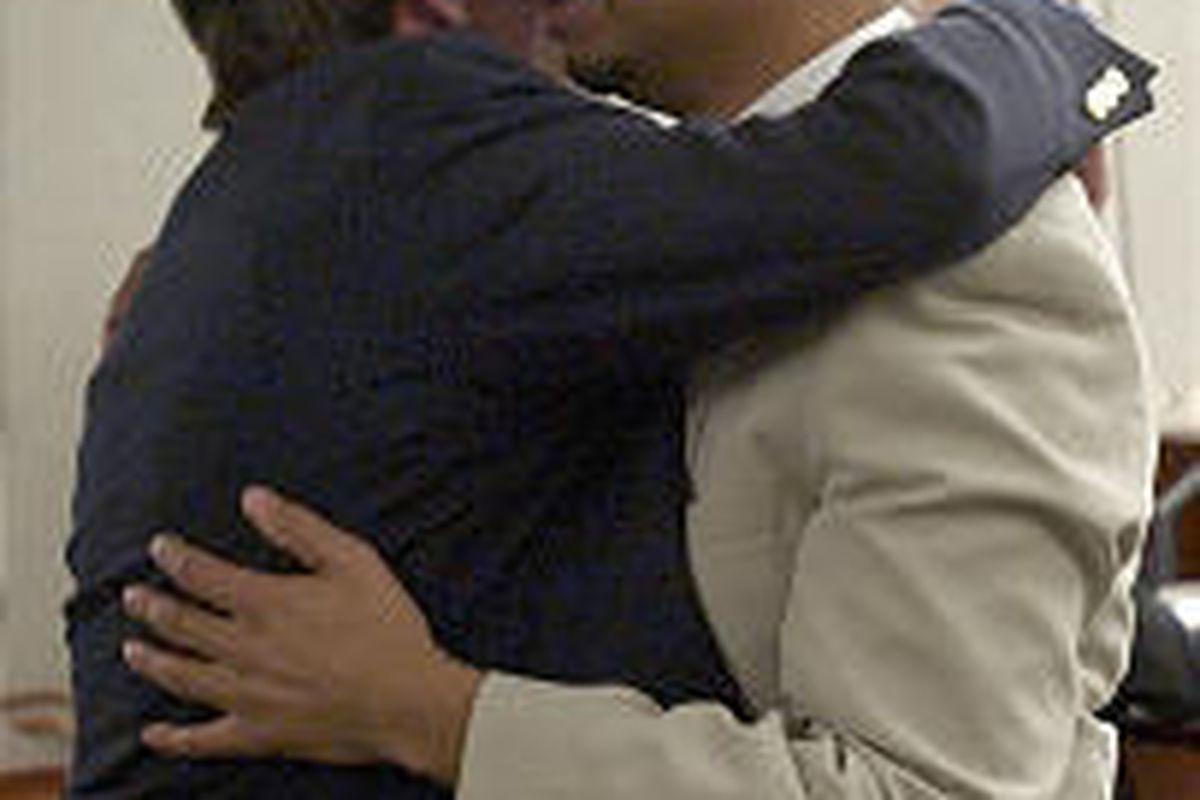 David Valken-Leduc, right, embraces his half-brother Sean Valken-Leduc after being found guilty of killing motel clerk Matthew John Whicker.
