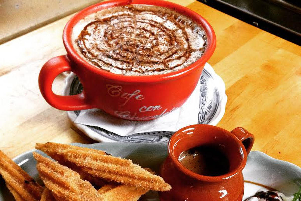 red cup with hot chocolate and plate of churros