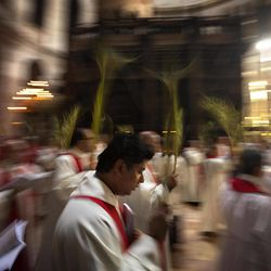 Catholic priests carry palm fronds at Church of the Holy Sepulchre, traditionally believed by many to be the site of the crucifixion and burial of Jesus Christ, in Jerusalem's Old city, Sunday, April 1, 2012. Palm Sunday marks for Christians, Jesus Christ's entrance into Jerusalem, when his followers laid palm branches in his path, prior to his crucifixion.