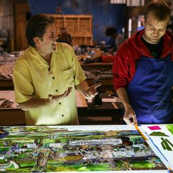 """Tom Holdman, left, and Nick Lawyer, right, discuss the progress of an art glass panel that will be part of """"The Roots of Knowledge,"""" a 200-foot-long stained glass installation for Utah Valley University, at Holdman Studios in Lehi on Friday, Nov. 4, 2016. A Guardian UK reporter called the work """"one of the most spectacular stained glass windows made in the past century."""""""