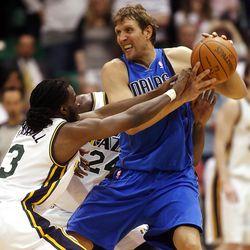 Utah Jazz forward DeMarre Carroll (3) and teammate Utah Jazz forward Paul Millsap (24) defend Dallas Mavericks forward Dirk Nowitzki (41) as the Utah Jazz and the Dallas Mavericks play Monday, April 16, 2012 in Salt Lake City.