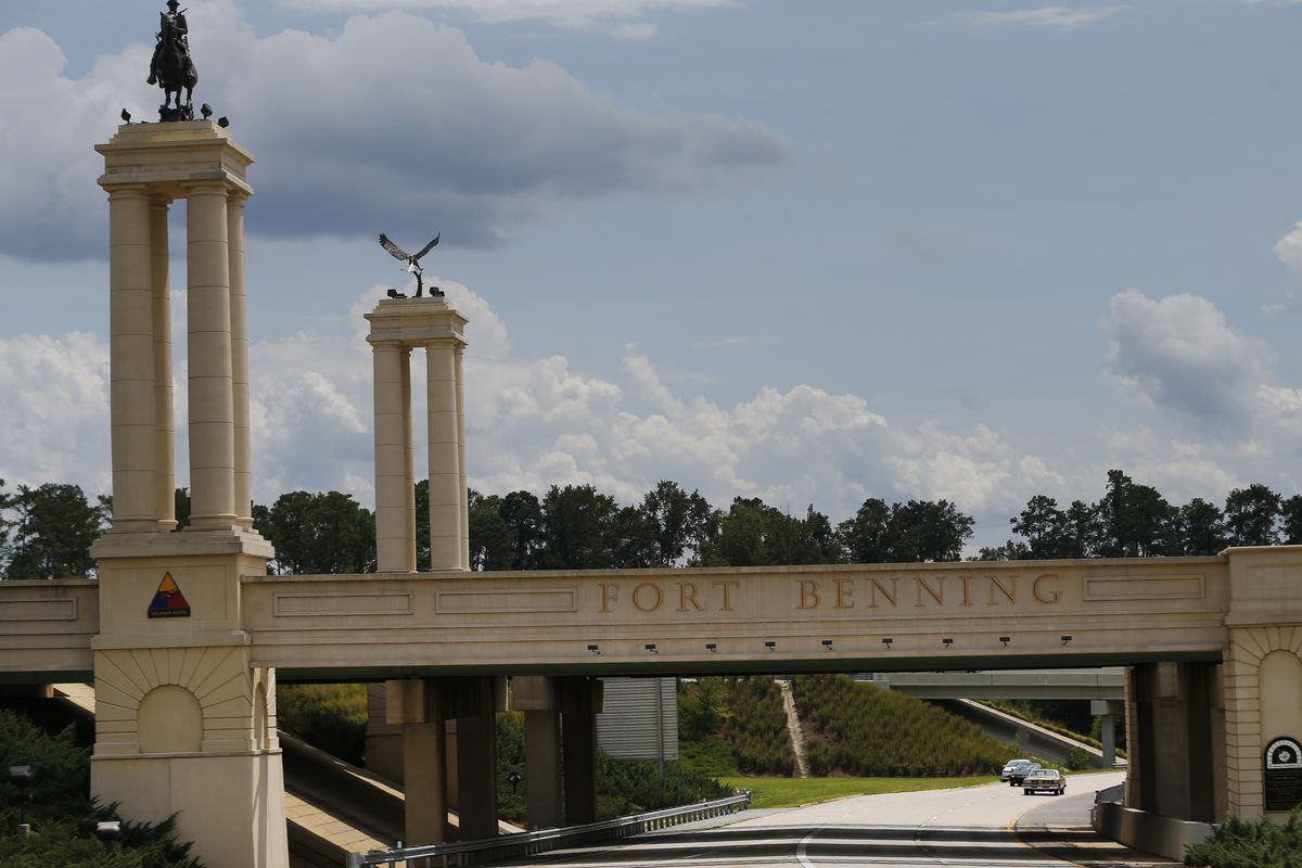 A bridge with decorative columns spans a highway in Georgia.