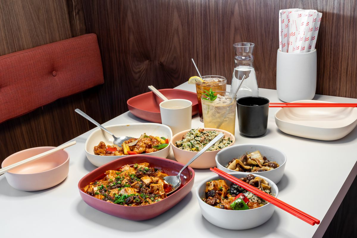 A spread of dishes including mapo tofu, sweet-and-sour chicken, a side of cultivated mushrooms, and Jade fried rice