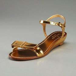 "<a href=""http://www.gilt.com/sale/women/kate-spade-new-york-shoes/product/105440483-kate-spade-new-york-shoes-vonya-wedge-sandal"">Vonya wedge sandal</a>, $139 (was $225)"