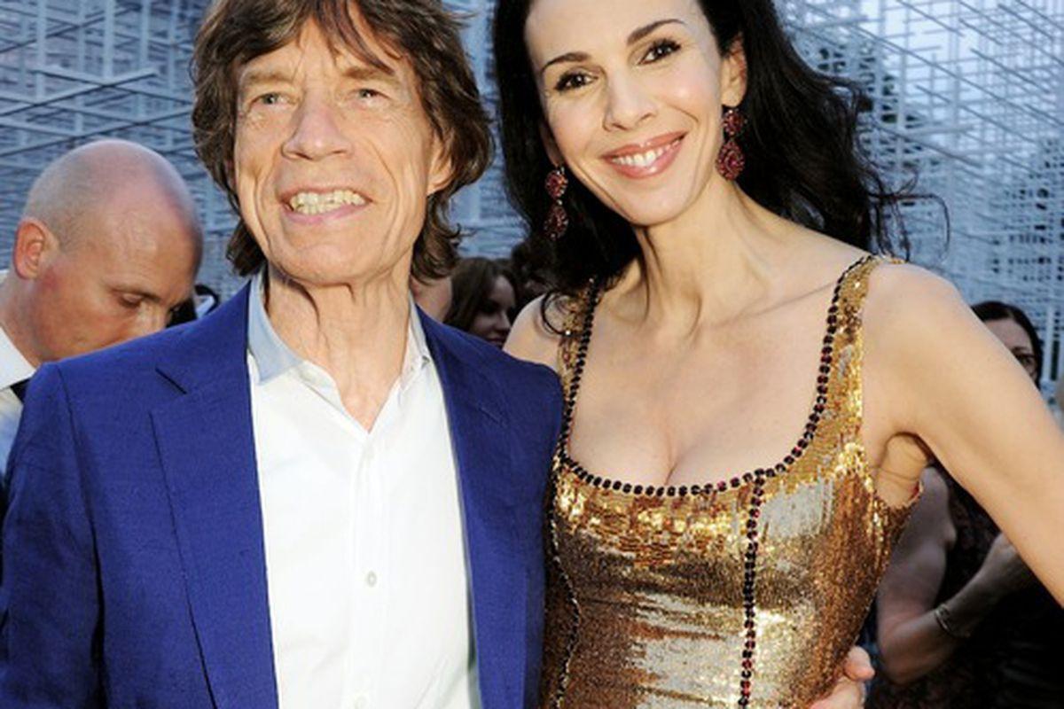 L'Wren Scott with partner Mick Jagger, via Getty