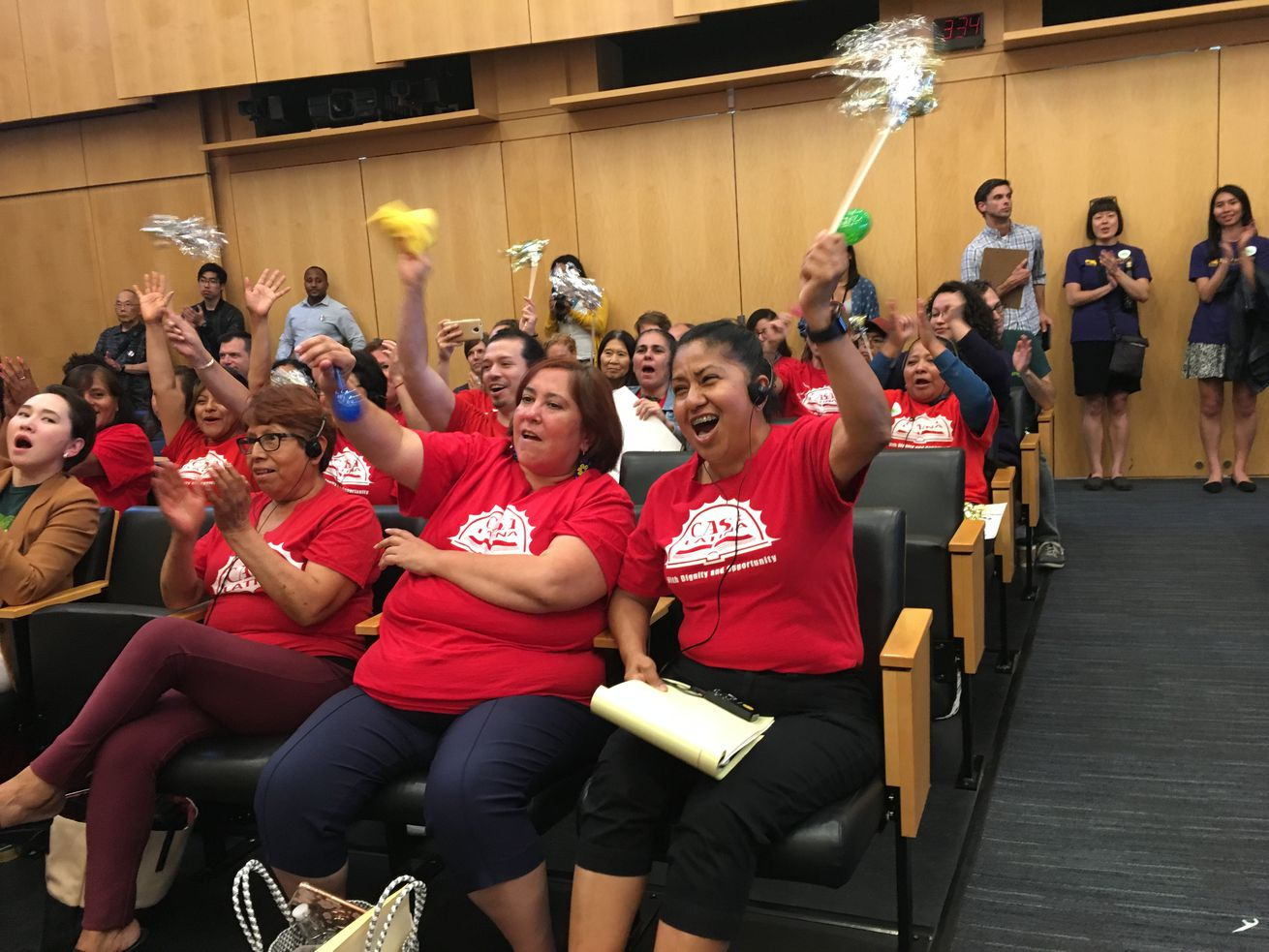 Advocates with Casa Latina celebrate the passage of the Domestic Workers' Bill of Rights.