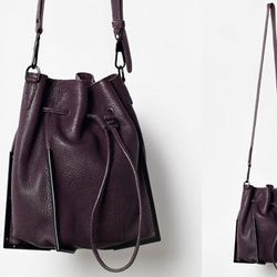 """<b>3.1 Phillip Lim</b> Scout Small Drawstring Crossbody in Raisin, <a href=""""http://www.31philliplim.com/shop/category/womens_accessories/bags#scout-small-drawstring-crossbody-3"""">$750</a>"""