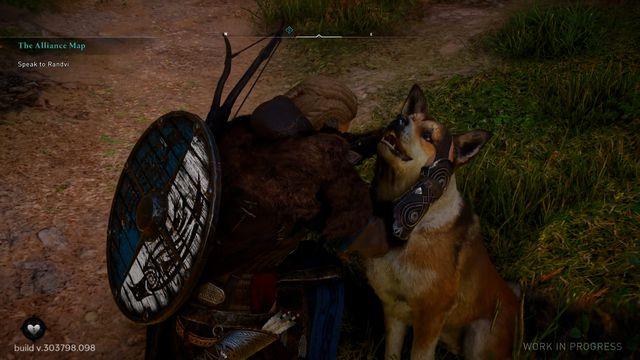 Eivor petting a big ol' dog in Assassin's Creed Valhalla