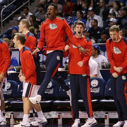 Gonzaga Bulldogs' bench erupts after a dunk as BYU and Gonzaga play in an NCAA basketball game in the Marriott Center in Provo on Saturday, Feb. 24, 2018.