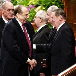 LDS Church President Thomas S. Monson, left, shares a laugh with Elder Jeffrey R. Holland of the Quorum of Twelve at the end of the Saturday afternoon session of conference in the Conference Center in Salt Lake City.