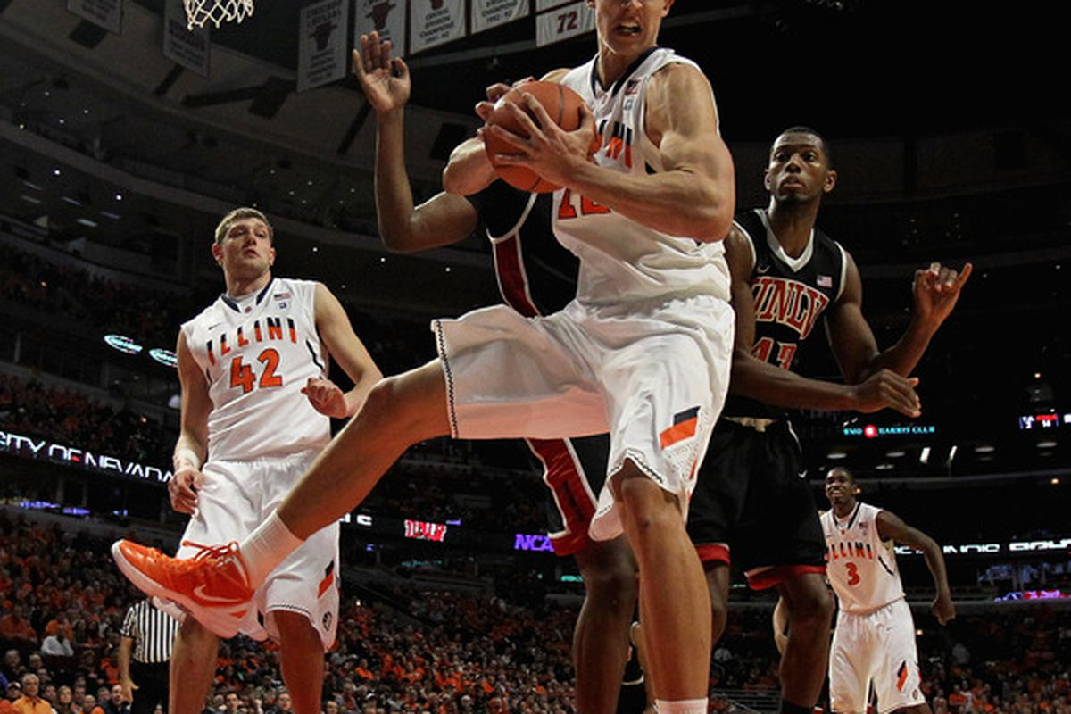 CHICAGO, IL - DECEMBER 17: Meyers Leonard #12 of the Illinois Fighting Illini grabs a rebound against the UNLV Rebels at United Center on December 17, 2011 in Chicago, Illinois. UNLV defeated Illinois 64-48. (Photo by Jonathan Daniel/Getty Images)