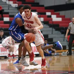 Maine South's  Essam Hamwi (21) dribbles past Crane's Jimarius Sneed (5) in their 60-40 win in Park Ridge, Saturday, February 9 2019.   Kevin Tanaka/For the Sun Times
