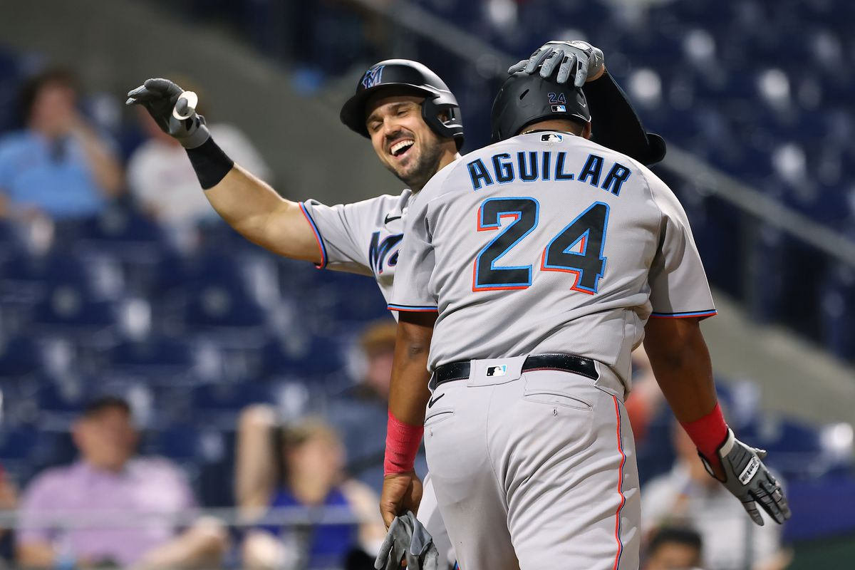 Adam Duvall #14 of the Miami Marlins celebrates his two-run home run with Jesús Aguilar #24 during the ninth inning of a game at Citizens Bank Park