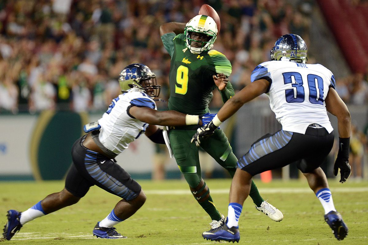 USF quarterback Quinton Flowers threw for 199 yards and a touchdown along with an interception against Memphis.