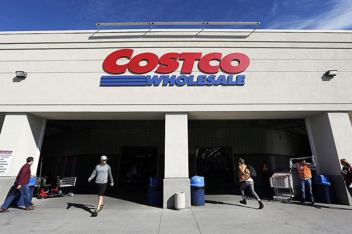 In this file photo, customers enter and leave Costco in Salt Lake City, Friday, Oct. 30, 2015.