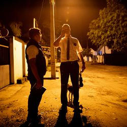 Elder Tanner McKee talks on the phone while he and his companion, Elder Pedro Cabral, left, both missionaries for The Church of Jesus Christ of Latter-day Saints, wait to escort a family to the local chapel, where they will be baptized, in Paranaguá, Brazil, on Saturday, June 1, 2019.