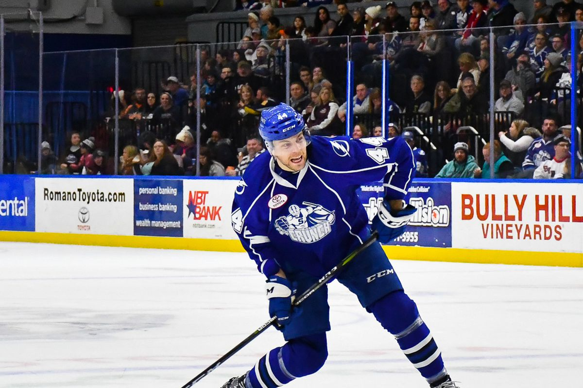 Syracuse Crunch Erik Cernak 44 Leans Into A Shot At The Utica Comets Net In American Hockey League Ahl Action At The War Memorial Arena In Syracuse