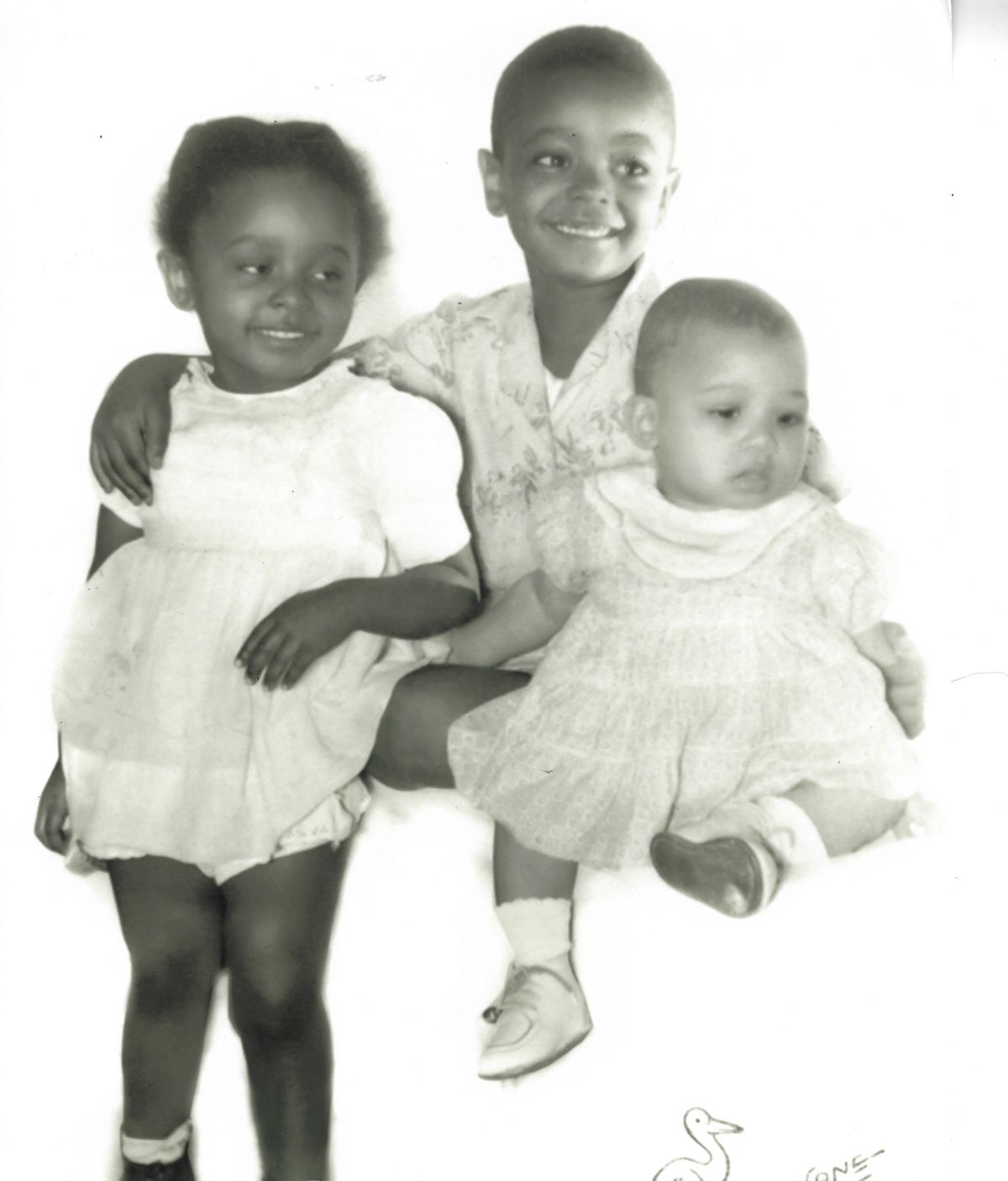 Wilton Gregory, here, with his two siblings Elaine (left) and Claudia, was raised by his mother, Ethel Duncan Gregory, and his grandmother, Etta Mae Duncan, in an apartment complex in South Side Englewood during the 1950's and '60s.