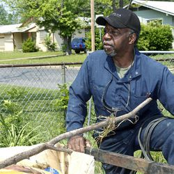 In this Monday, April 9, 2012 photo, Douglas Warner is pictured during an interview in Tulsa, Okla. In the days after what authorities describe as racially-motived shootings that killed three people and wounded two more earlier this month, the national spotlight was on the crime-ridden neighborhood, where iron bars on windows belie the toys strewn in people's front yards. The Rev. Jesse Jackson and the national president of the NAACP showed up. Local church and civic leaders pledged things would finally change for the better.