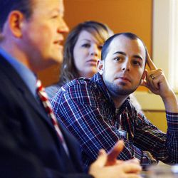 Quynn Udell, a delegate, and his wife, Chelsea, listen to Carl Wimmer, left, a candidate for the 4th Congressional District, at IHOP in West Jordan, Wednesday, April 4, 2012.