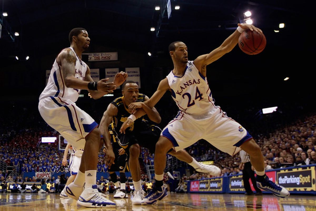 LAWRENCE KS - FEBRUARY 07:  Travis Releford #24 of the Kansas Jayhawks grabs a rebound as Matt Pressey #3 of the Missouri Tigers defends during the game on February 5 2011 at Allen Fieldhouse in Lawrence Kansas.  (Photo by Jamie Squire/Getty Images)