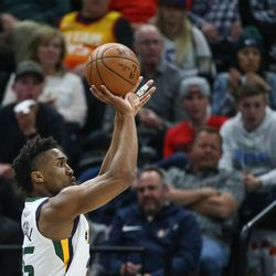 Utah Jazz guard Donovan Mitchell (45) shoots a 3-pointer during the game against the Golden State Warriors at Vivint Arena in Salt Lake City on Tuesday, April 10, 2018.