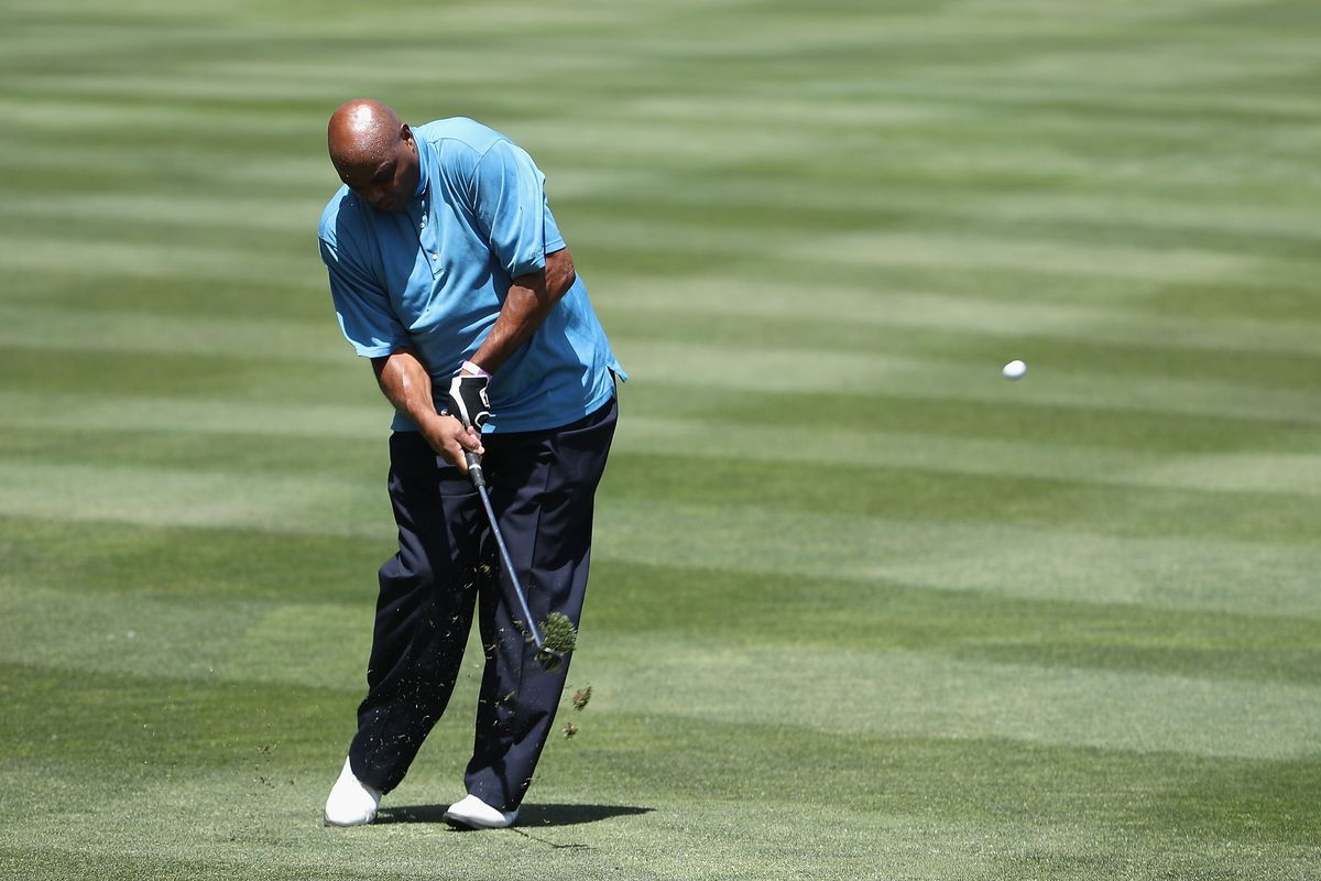 Former NBA athlete and current television analyst Charles Barkley chips up to the first green during round one of the American Century Championship at Edgewood Tahoe South golf course on July 10, 2020 in Lake Tahoe, Nevada.