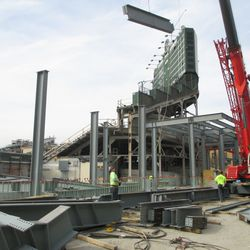 Girder being lifted into the right-center field bleacher patio -