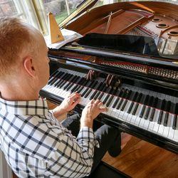 Jon Schmidt sits and plays the piano in his home in Provo on Friday, Nov. 24, 2017.
