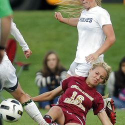 Maple Mountains's #16 Kaitlyn Bailey, down, slides in front of Timpanogos' #4 Lizzy Jessop during play Tuesday, Sept. 25, 2012. Maple Mountain won 2-1.