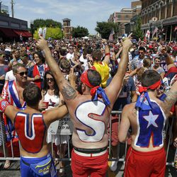 United States fans cheer before the start of the World Cup soccer match between the United States and Belgium at a viewing party in Indianapolis, Tuesday, July 1, 2014.