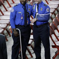 James Speer, right, and Tony Grigsby, two Transportation Security Administration officers who were injured in the Nov. 1 shooting at Los Angeles International Airport, attend a public memorial service for slain TSA officer Gerardo Hernandez on Tuesday, Nov. 12, 2013, in Los Angeles.  Hernandez was the first TSA officer killed in the line of duty when a gunman pulled a rifle from a bag and shot the 39-year-old father of two at the airport. The two TSA officers and a teacher were injured before airport police wounded the gunman, Paul Ciancia.