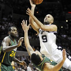 Spurs' Tony Parker (9), here in action this season against Utah, has been a thorn in Jazz's side before. h Jazz's Devin Harris and Paul Millsap (24) during the second half of an NBA basketball game, Sunday, April 8, 2012, in San Antonio. (AP Photo/Darren Abate)