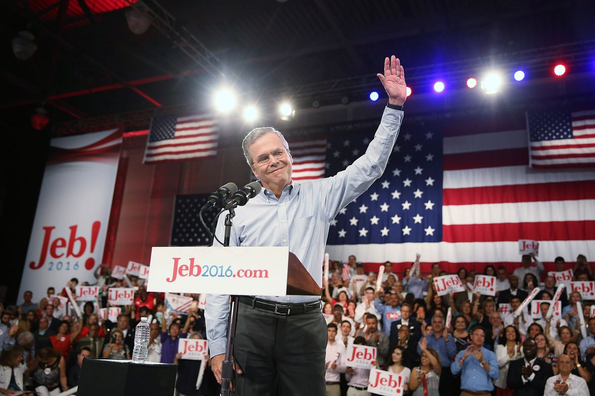 Former Florida Governor Jeb Bush waves on stage as he announces his candidacy for the Republican presidential nomination during an event at Miami-Dade College - Kendall Campus on June 15 , 2015.