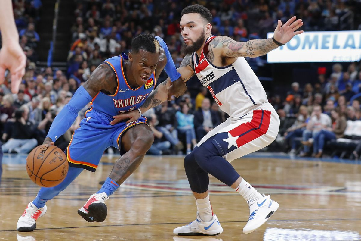 Oklahoma City Thunder guard Dennis Schroder drives to the basket around Washington Wizards guard Chris Chiozza during the second half at Chesapeake Energy Arena.