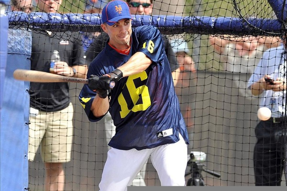 February 27, 2012; Port St Lucie, FL, USA;   New York Mets third baseman David Wright (5) wears a Michigan Wolverines football jersey during spring training workouts at Digital Domain Park. Mandatory Credit: Brad Barr-US PRESSWIRE