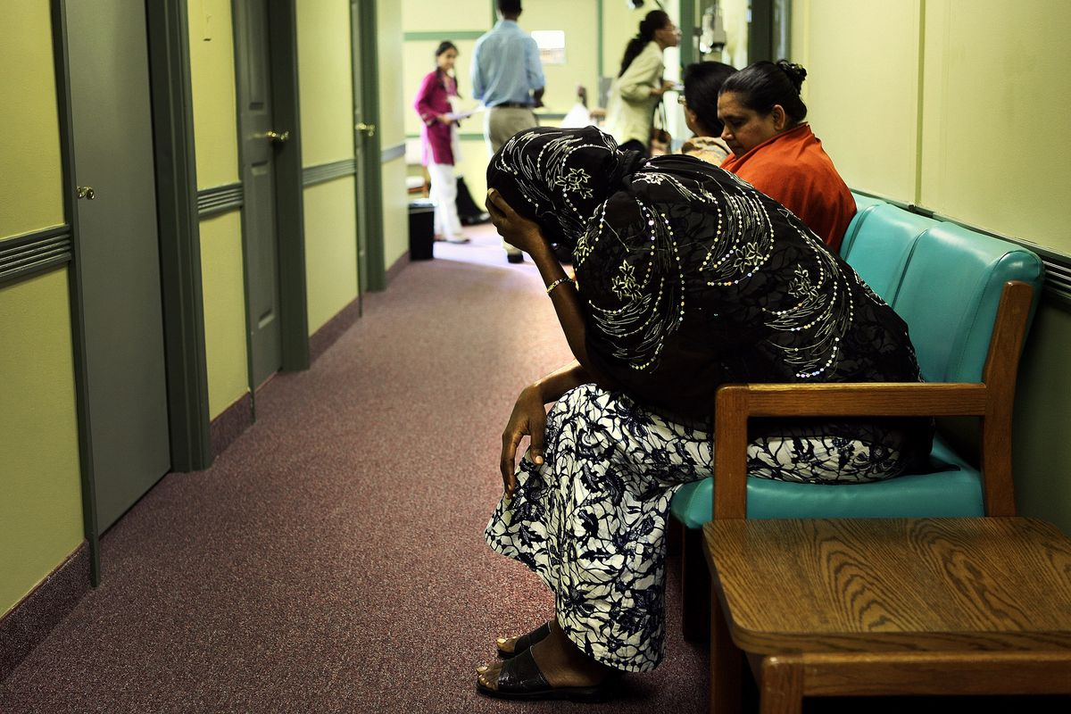 Women wait for care at a Maryland clinic that serves the uninsured