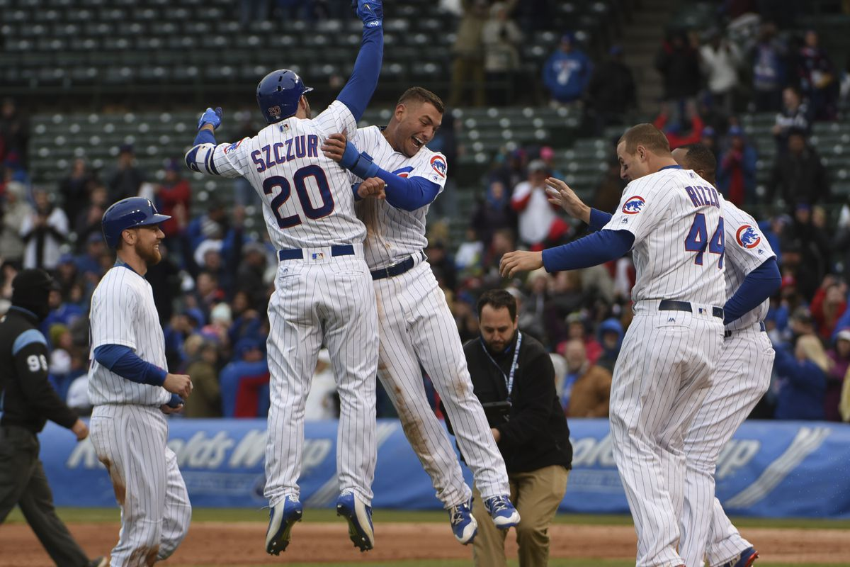 CHICAGO, IL - MAY 04: The Chicago Cubs celebrate their walk-off win against the Philadelphia Phillies in the thirteenth inning on May 4, 2017 at Wrigley Field  in Chicago, Illinois. The Cubs won 5-4. (Photo by David Banks/Getty Images)