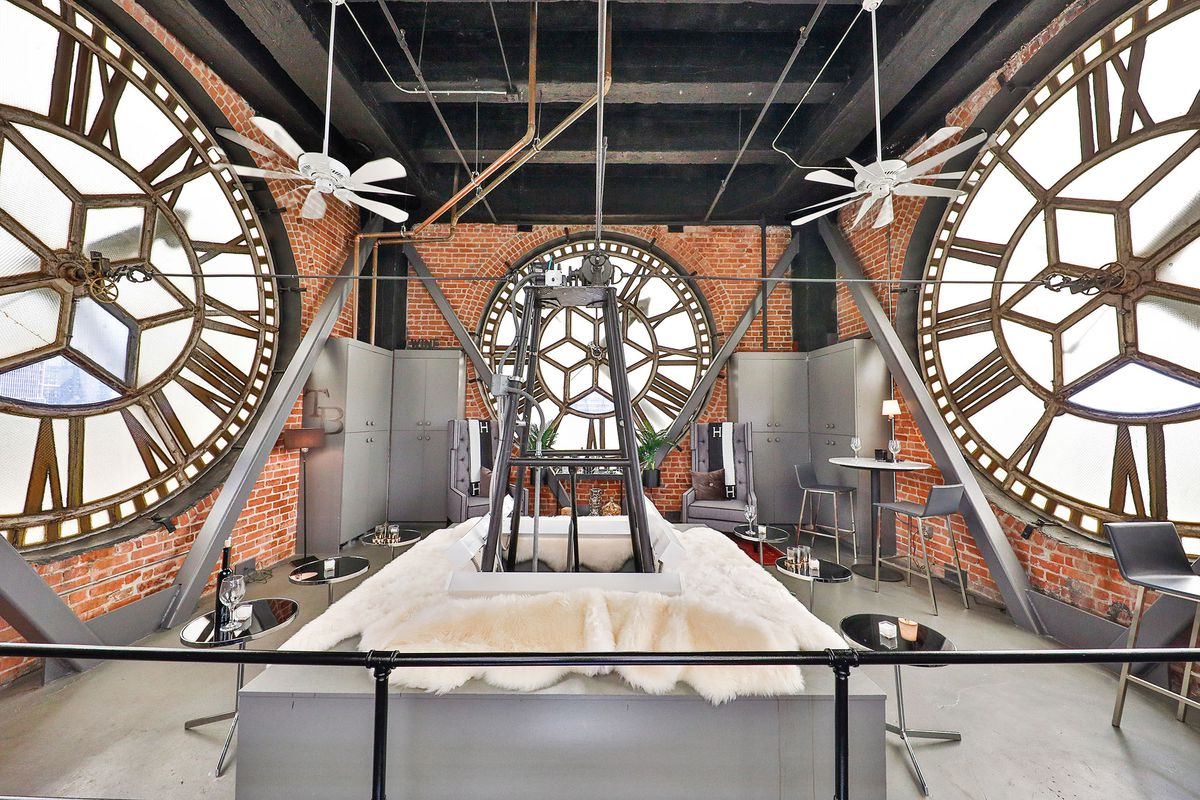 A Brock room with clock faces on every side.