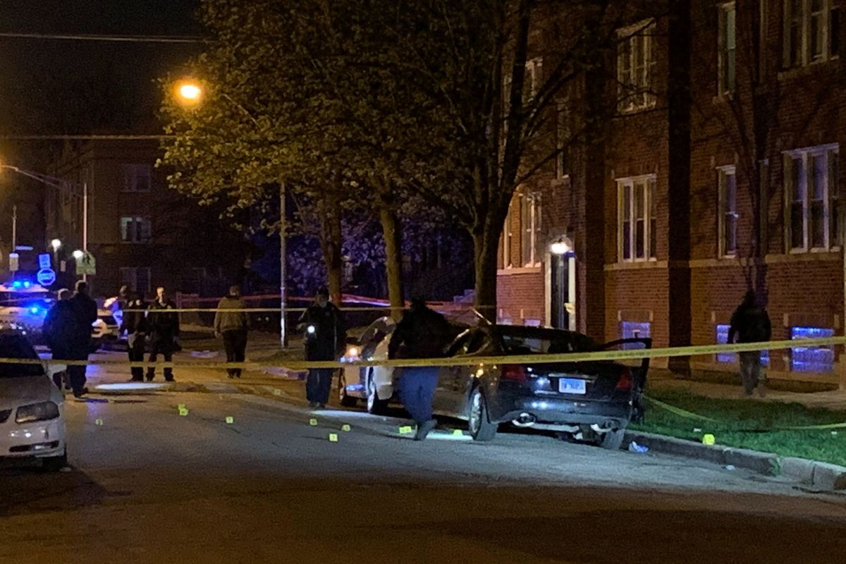 Police investigate the scene where two people were shot, one fatally April 26, 2020, in Galewood.