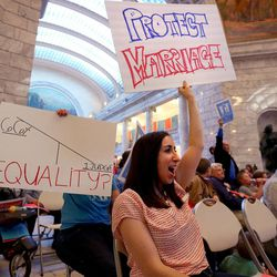 """Rachel Spencer of South Salt Lake attends a """"Stand for Marriage"""" rally at the state Capitol in Salt Lake City on Tuesday, April 28, 2015."""
