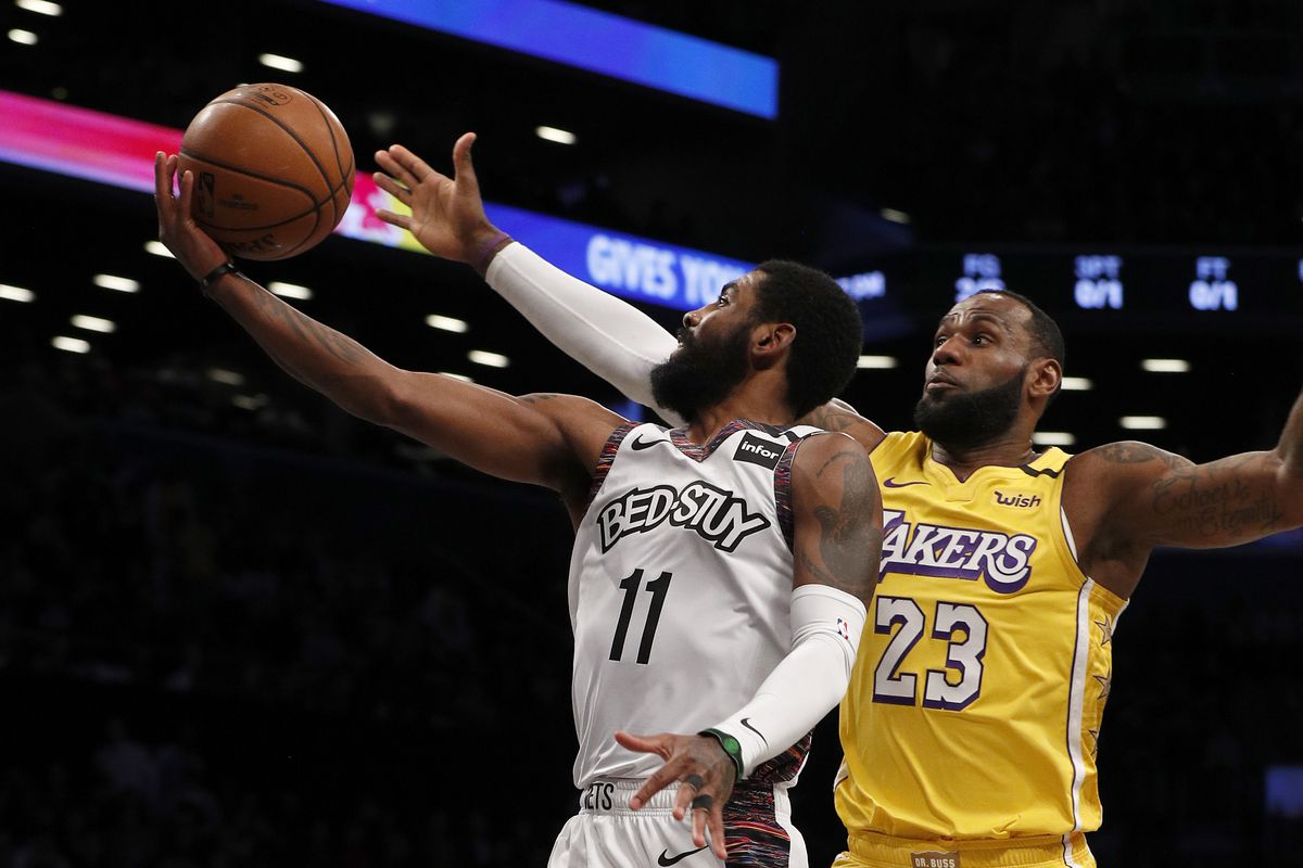 Kyrie Irving #11 of the Brooklyn Nets in action against LeBron James #23 of the Los Angeles Lakers at Barclays Center on January 23, 2020 in New York City. The Lakers defeated the Nets 128-113.
