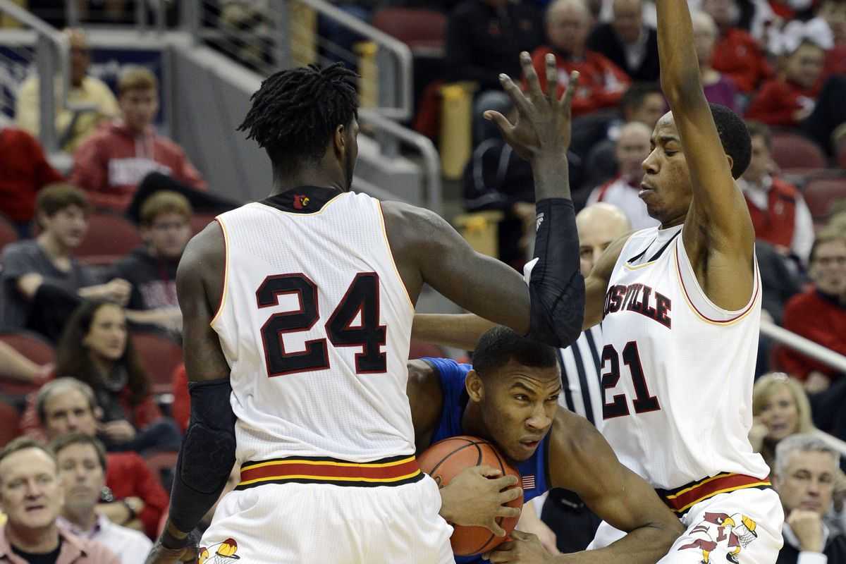 Jan 17, 2015; Louisville, KY, USA; Louisville Cardinals forward Montrezl Harrell (24) and guard Shaqquan Aaron (21) trap Duke Blue Devils guard Rasheed Sulaimon (14) during the second half at KFC Yum! Center. Duke defeated Louisville 63-52