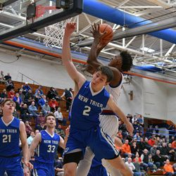 New Trier's Noah Osher (2) attempts to block at shoot put up by Curie's DaJuan Gordon (3), Friday 12-28-18. Worsom Robinson/For Sun-Times