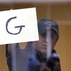 A reporter holds up signs at federal court in Salt Lake City after it was announced that the jury in the Brian David Mitchell trial reached a guilty verdict.