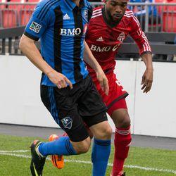 Ashtone Morgan deals with Justin Mapp