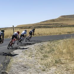 A small group of riders navigates a corner during Stage 3 of the Tour of Utah on Antelope Island on Thursday, Aug. 15, 2019.