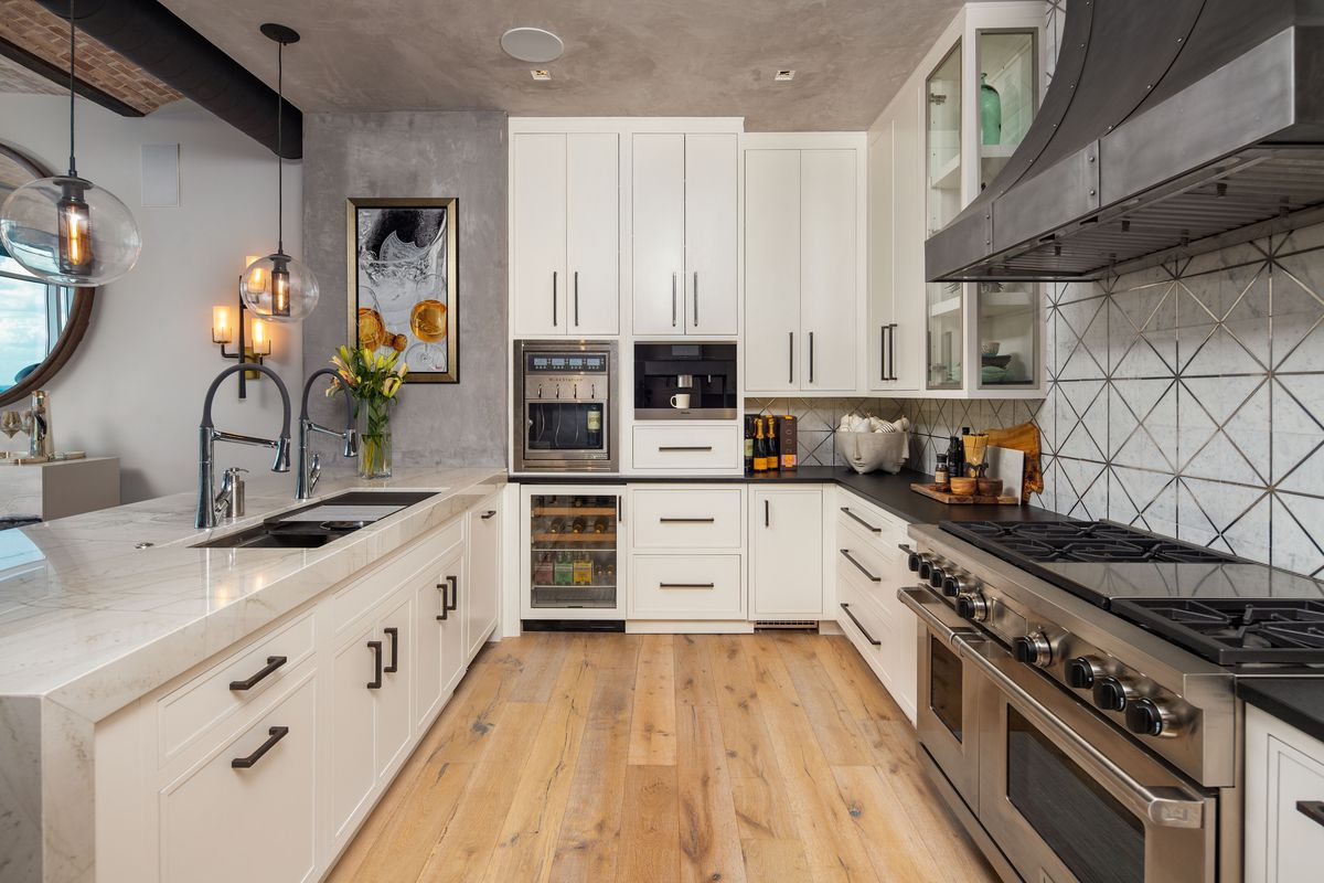 A redone kitchen with concrete ceilings.