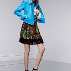 Leather jacket in Dresden blue, $199.99; sleeveless tee in First Date print, $26.99; pleated skirt in Nolita print, $29.99; flat sandals, $29.99