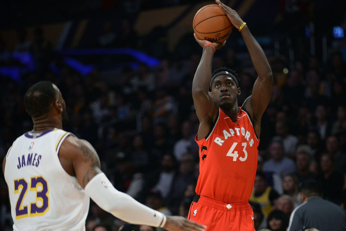 Toronto Raptors forward Pascal Siakam shoots against Los Angeles Lakers forward LeBron James during the first half at Staples Center.